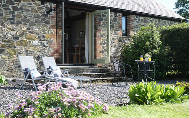 Monkstone Cottge - relax and enjoy the views in the private garden at Monkstone Cottage