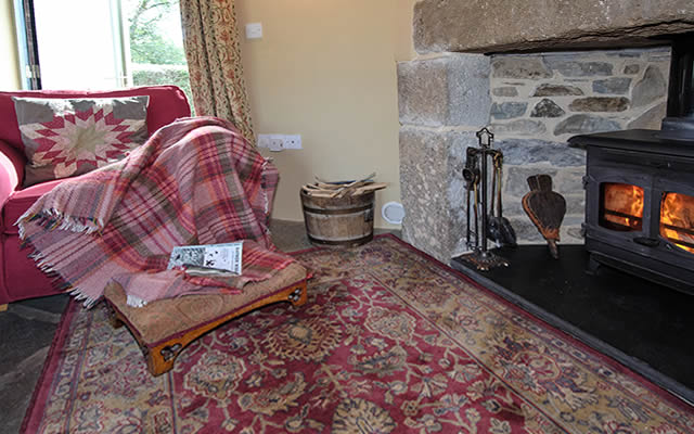 Monkstone Cottage - cosy lounge with woodburning stove