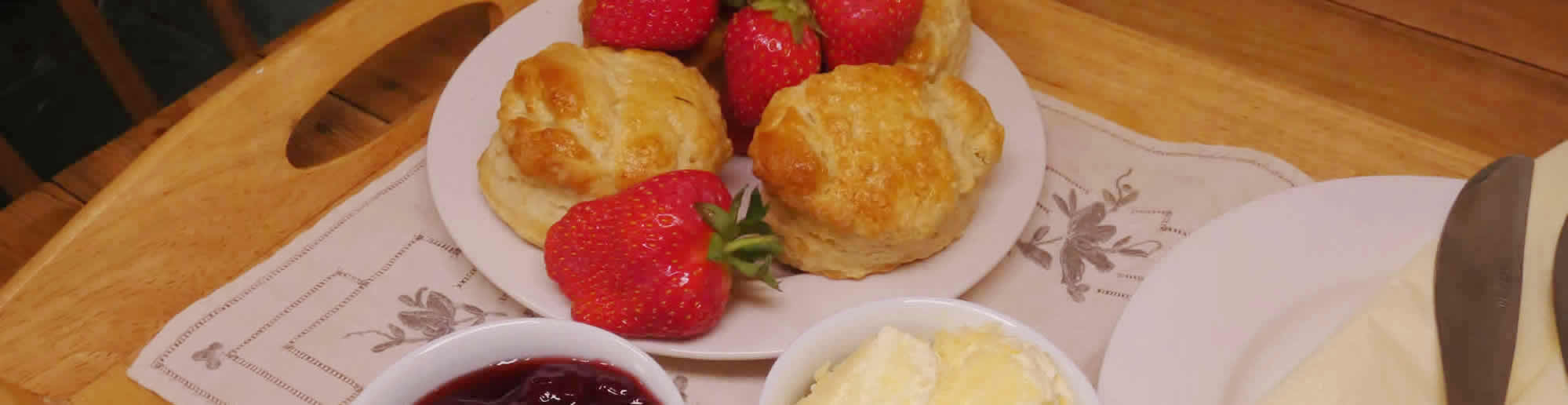 Relax over a traditional Devon cream tea on arrival at our holiday cottages